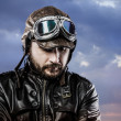 Royalty-Free Stock Photo: Pilot with glasses and vintage hat with proud expression over cl