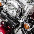 Closeup of a big chromium motorcycle engine, shiny chrome plated - Stock Photo
