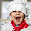 Funny child dressed as a cook — Stock fotografie