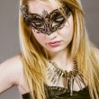 Beautiful blonde in black leather jacket, mysterious mask and si - Stok fotoğraf