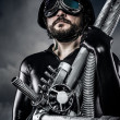 Man of the future with huge laser cannon shotgun - Stock Photo