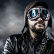 Pilot with glasses and vintage hat with proud expression - Stock Photo