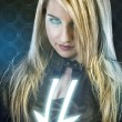Sexy young woman with blue neon lights, future warrior costume, - Stock Photo