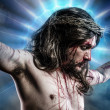 Calvary jesus, man bleeding, representation of passion with blue — Stock Photo #24640931