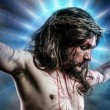 Calvary jesus, man bleeding, representation of passion with blue - Stock Photo