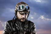 Pilot with glasses and vintage hat with proud expression over cl — Stock Photo
