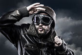Pilot with glasses and vintage hat with funny expression — Stock Photo