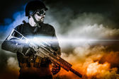 Assault soldier with rifle on apocalyptic clouds — Stock Photo