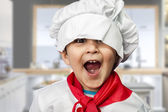 Funny child dressed as a cook — Stock Photo