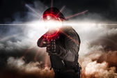 Soldier aiming assault rifle laser sight — Stock Photo