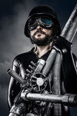 Man of the future with huge laser cannon shotgun — Foto Stock
