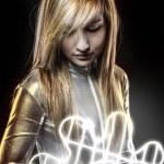Fiber optics concept, future blonde dressed in silver — Stock Photo #25237717
