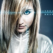 图库照片: Communications concept, young blonde with silver latex jumpsuit