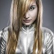 Serious young blond, concept future and modernity, girl in silve — Stock Photo #25237701