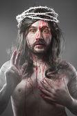 Jésus christ avec un halo de lumière blanche sur fond gris — Photo