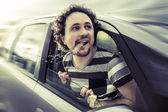 Concept of freedom, drive to the beach, happy man with dog tongu — Stock Photo