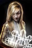 Fiber optics concept, future blonde dressed in silver — Stock Photo