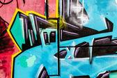 Blue signs, colorful graffiti, abstract grunge graffiti background — Stock Photo