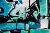 Blue signs, colorful graffiti, abstract grunge grafiti background — Stock Photo