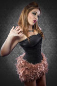 Beautiful woman smiling and dancing mischievous — Stock Photo