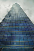 Clouds reflect on crystal skyscraper — Stock Photo