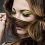 Spanish beautiful woman with long blond hair, painted yellow eye — Stock Photo