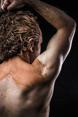 Ancient warrior covered in mud, back — Stock Photo