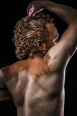 Pictish warrior covered in mud and naked, detail muscle — Stock Photo