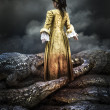 Stock Photo: Medieval young girl surrounded by crocodiles