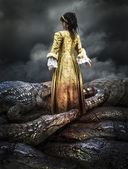 Medieval young girl surrounded by crocodiles — Stock Photo