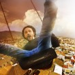 Concept crazy, mad and happy man climbed a swing — Stok fotoğraf