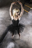 Posing, ballet dancer in an industry area, sensual blonde woman — Stock Photo