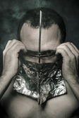 Rage, concept of fear and terror, naked man with hardware in the face — Stok fotoğraf