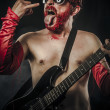 Stock Photo: Heavy metal. Rock star playing solo on guitar