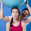 Happy athletic couple with fitness ball.  — Stock Photo