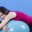 Постер, плакат: Young girl with big blue fit ball
