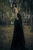 Gothic woman in dark forest, fantasy concept, dark queen — Stock Photo
