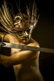 Sword, warrior or ancient god with golden mask and sword greatsw — Stock Photo