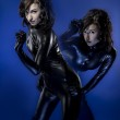 Twins in latex costume, sexy brunette — Stock Photo #34046249