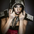 Stock Photo: Beautiful brunette woman in armor formed by mirror