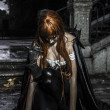 Sadness, Under the storm, Beautiful vampire woman in palace gate — ストック写真