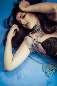 Chained, Fashion shoot of young brunette woman in fetish dress, — Stock Photo