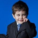 Kid, Businessman surprised, cute little boy portrait over blue c — Stock Photo