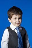 Leadership, cute little boy portrait over blue chroma background — Stock Photo