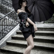 Japanese look, pretty young woman with black umbrella — Stock Photo