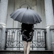 Pretty young woman with black umbrella — Stok fotoğraf
