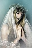 Christianity, woman dressed in white veil — Stock Photo