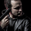 Risk, thief, armed man with black leather jacket, dangerous — Stock Photo #38085533