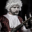 Musket and candle, gentleman rococo era wig — Stock Photo