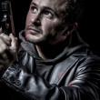 Thief, armed man with black leather jacket, dangerous — Stock Photo